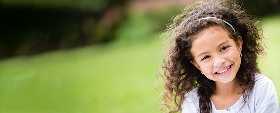 Kid with glasses smiling - Pediatric Dentist for Sandy Springs, GA